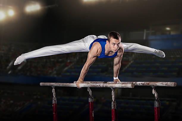 portrait of young man gymnasts - 体操競技 ストックフォトと画像