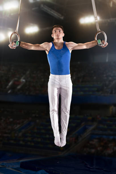 portrait of young man gymnasts - gymnastics stock pictures, royalty-free photos & images