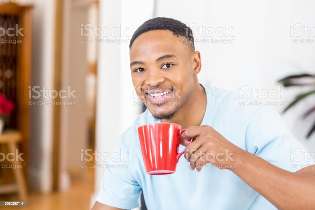 Portrait of young man having cup of coffee foto stock royalty-free