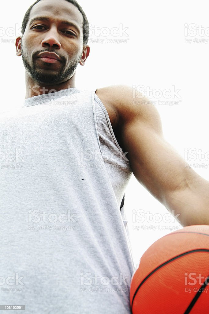 Portrait of Young Man Holding Basketball royalty-free stock photo