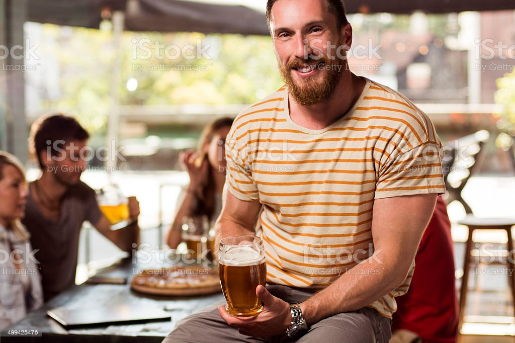 Portrait of young man in a bar stock photo