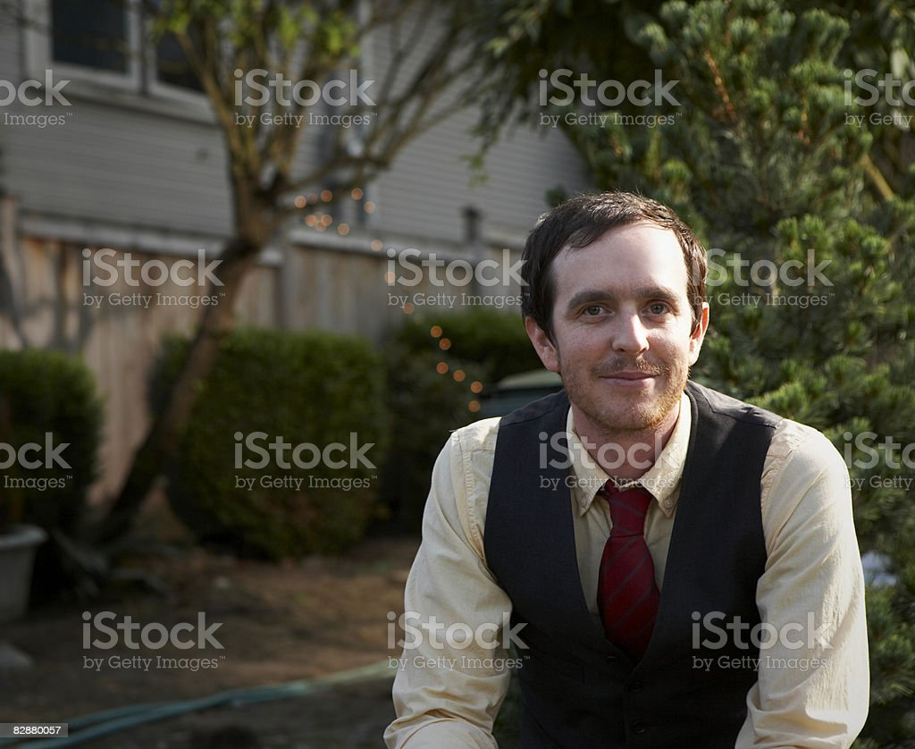 Portrait of young man in front yard royaltyfri bildbanksbilder