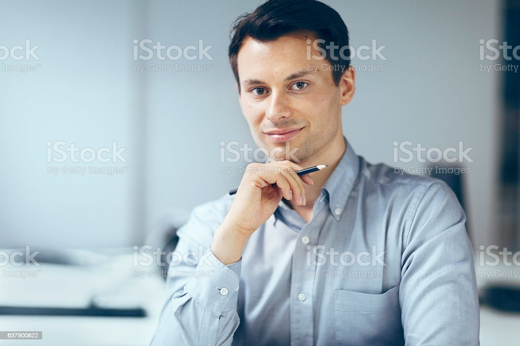 Portrait of young man in office stock photo