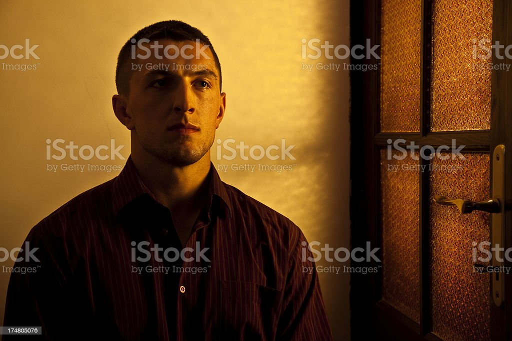Portrait of Young Man in Warm Sidelight stock photo