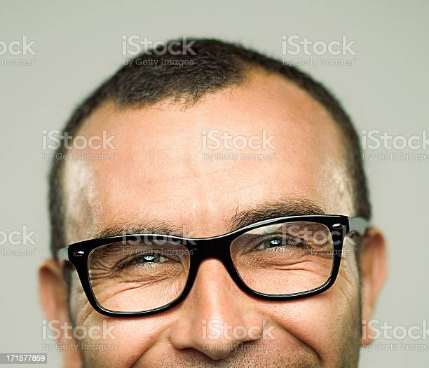 Portrait Of Young Man Laughing Stock Photo - Download Image Now