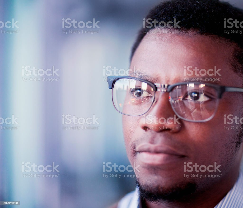 Portrait of young man looking ahead in office stock photo