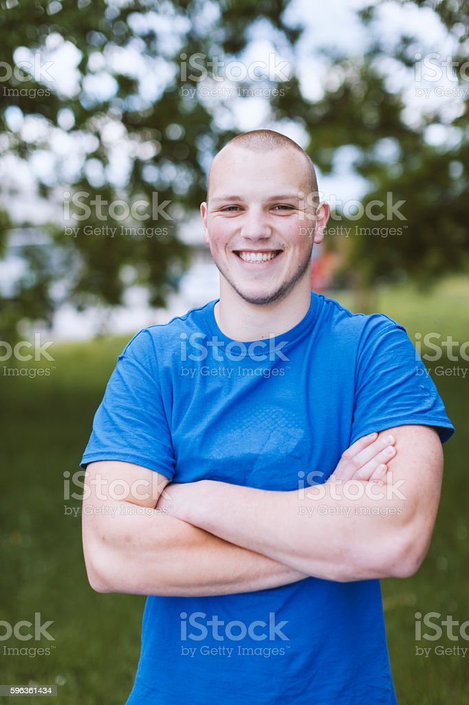 Portrait of Young Man Looking at Camera Outdoors royalty-free stock photo