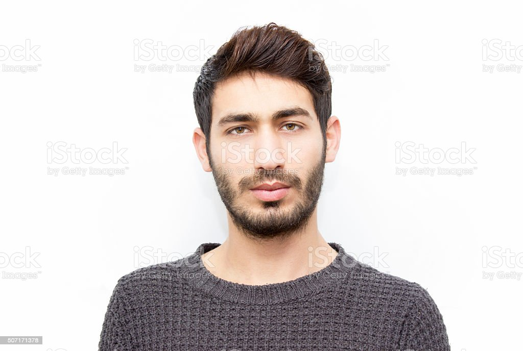 Portrait of young man looking at camera with blank expression stock photo