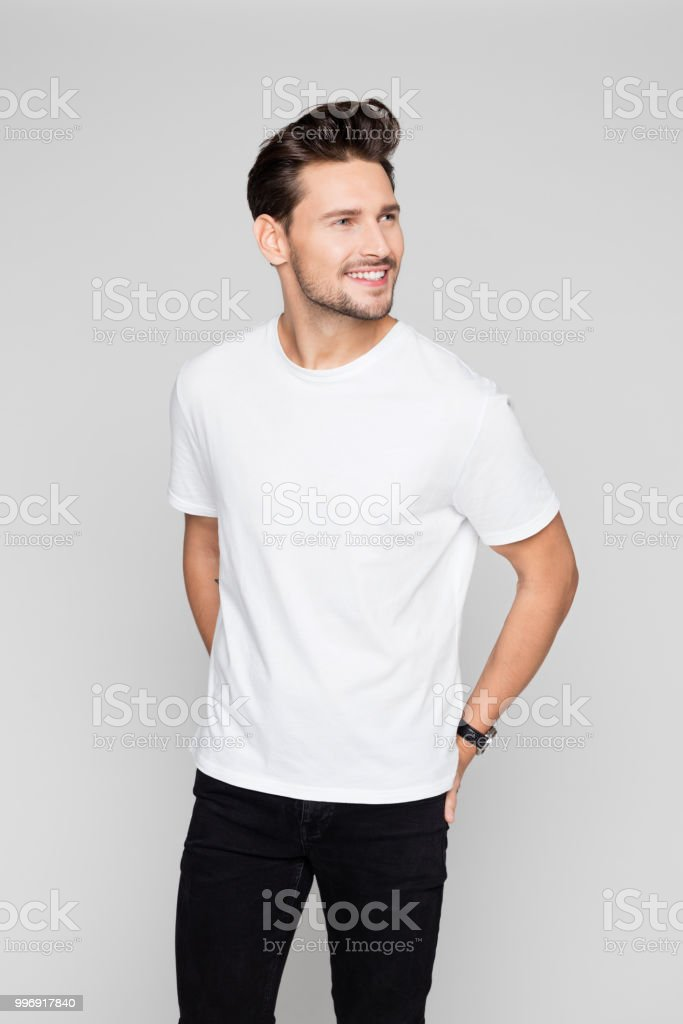 Portrait of young man looking away Portrait of young man looking away on grey background 25-29 Years Stock Photo