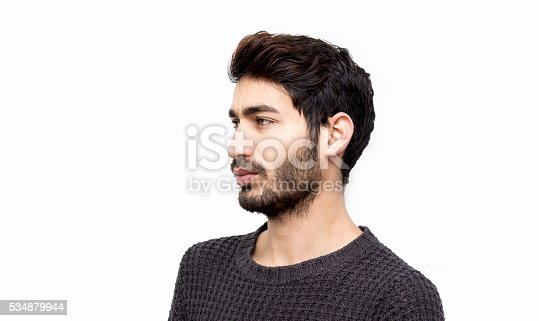 istock Portrait of young man looking away seriously over white backgrou 534879944