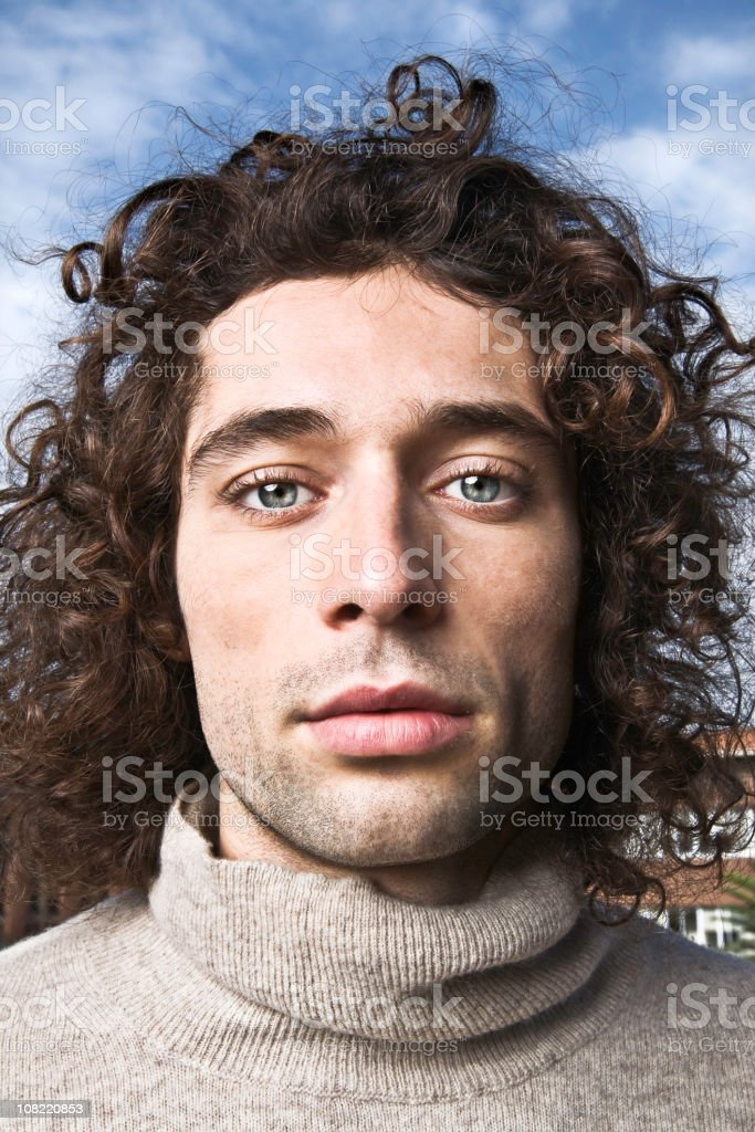 Portrait of Young Man Outside Wearing Turtle Neck Sweater stock photo