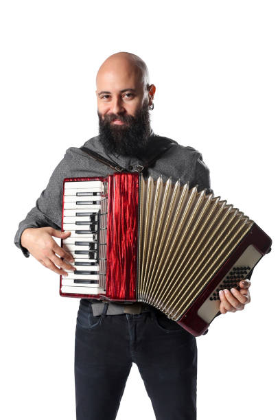 Portrait of Young Man Playing Accordian stock photo