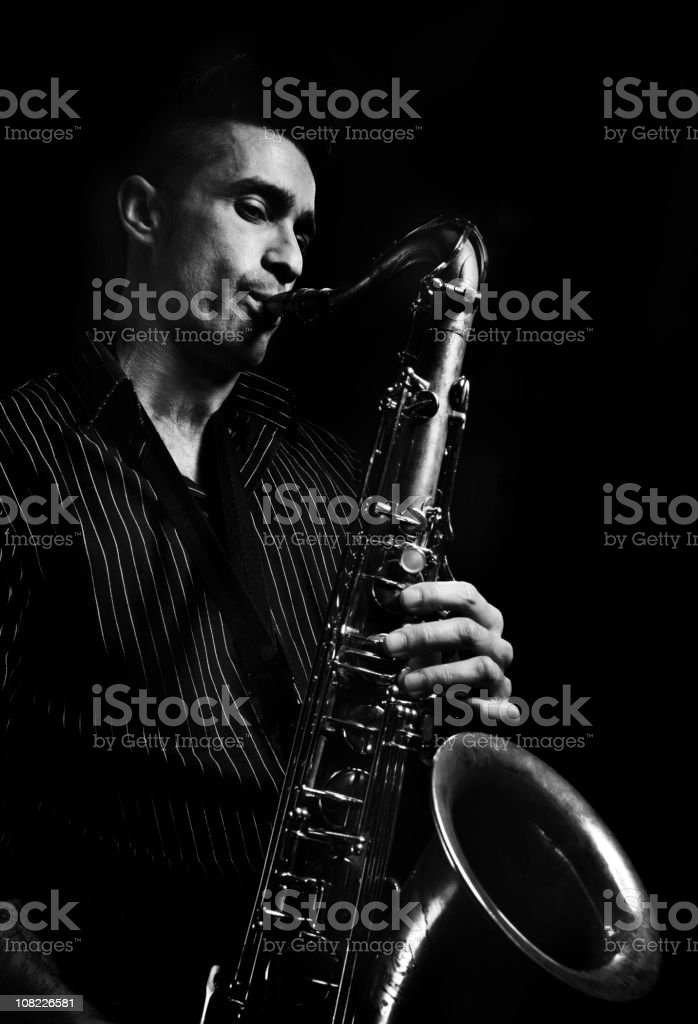 Portrait of Young Man Playing Saxophone, Black and White stock photo
