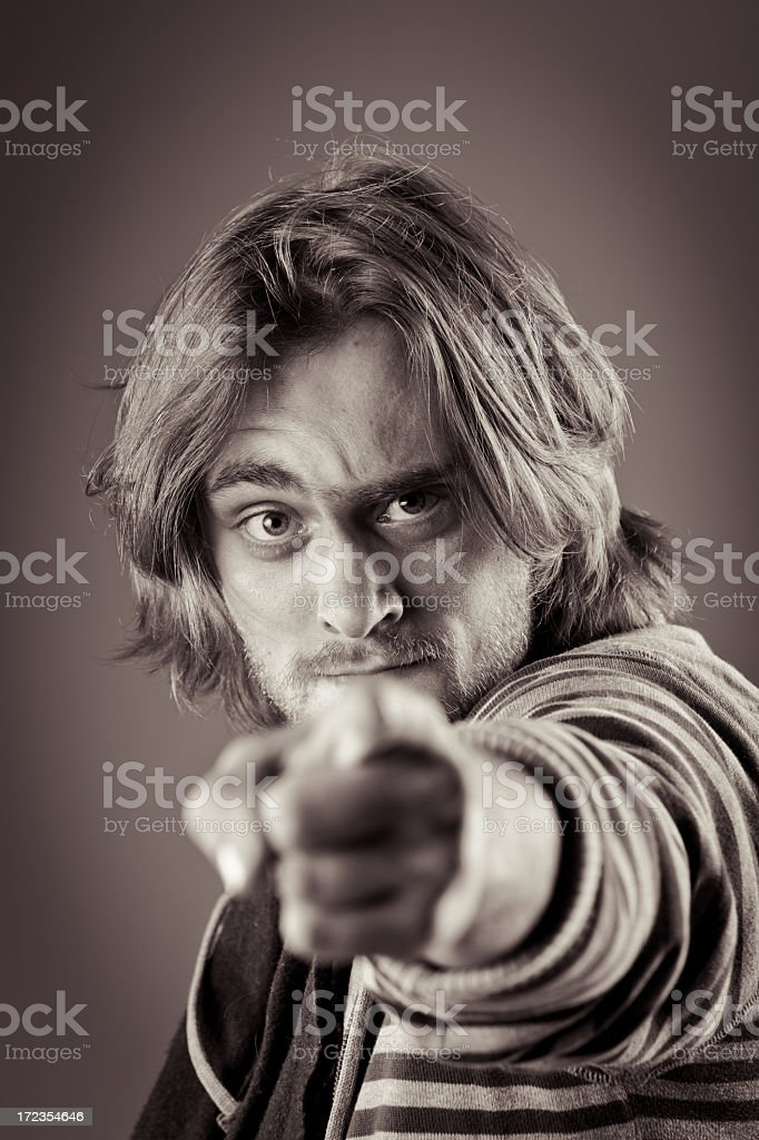 Portrait of young man pointing at you royalty-free stock photo