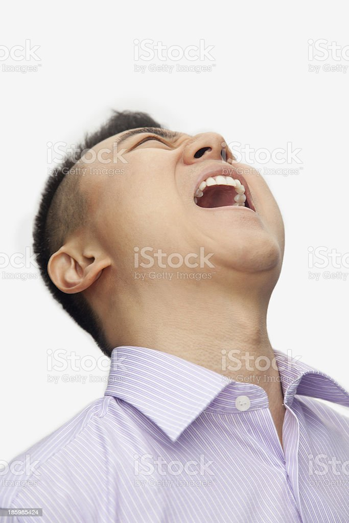 Portrait of young man shouting, close up studio shot royalty-free stock photo
