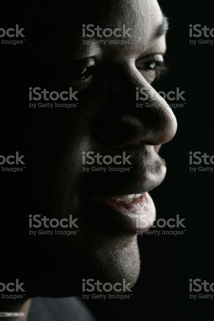 Portrait of Young Man Smiling, Low Key royalty-free stock photo