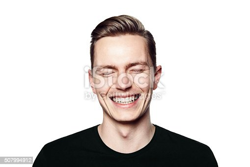 istock Portrait of young man smiling to camera 507994912