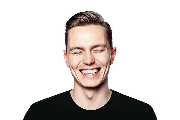 portrait of young man smiling to camera - one young man only stock photos and pictures