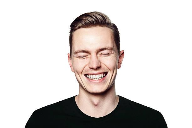 笑う若い男性のポートレートをカメラ ストックフォト