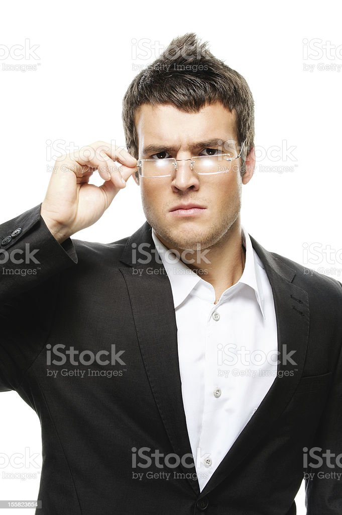 portrait of young man wearing suit and eyeglasses royalty-free stock photo