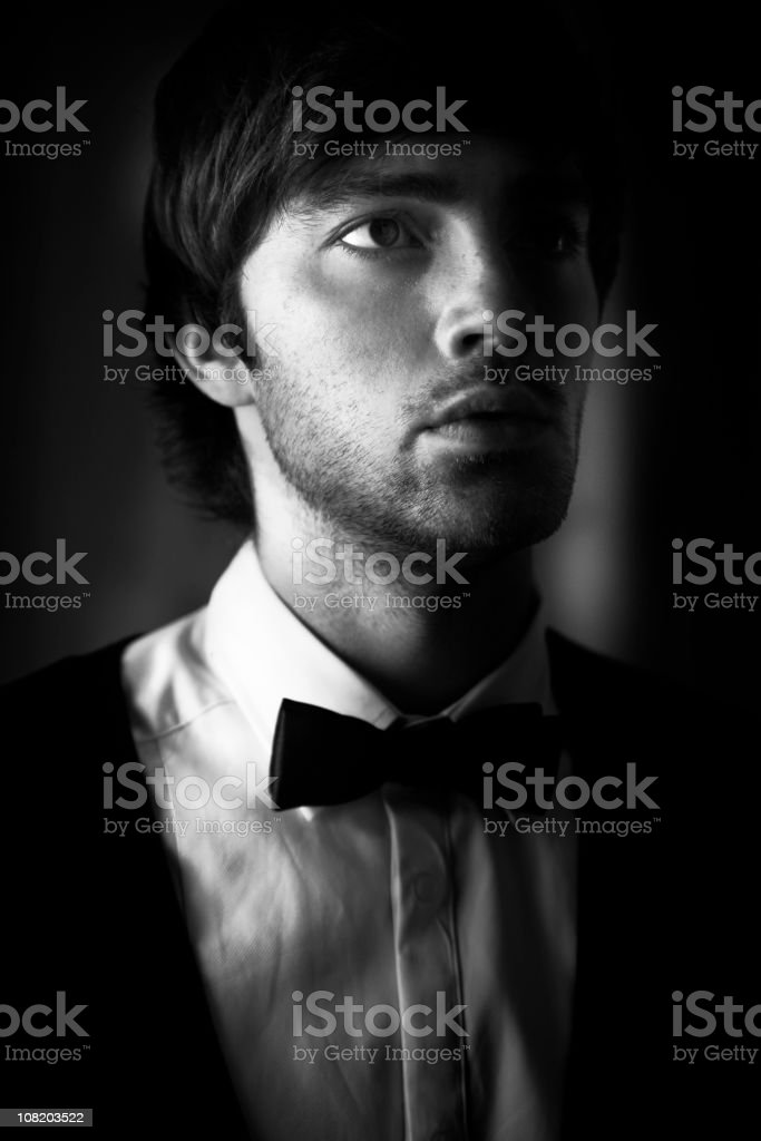 Portrait of Young Man Wearing Tuxedo, Black and White royalty-free stock photo