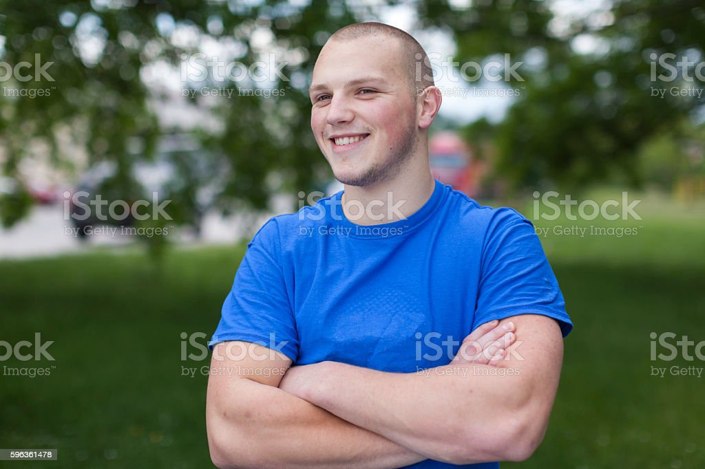 Portrait of Young Man with Crossed Arms Outdoors royalty-free stock photo