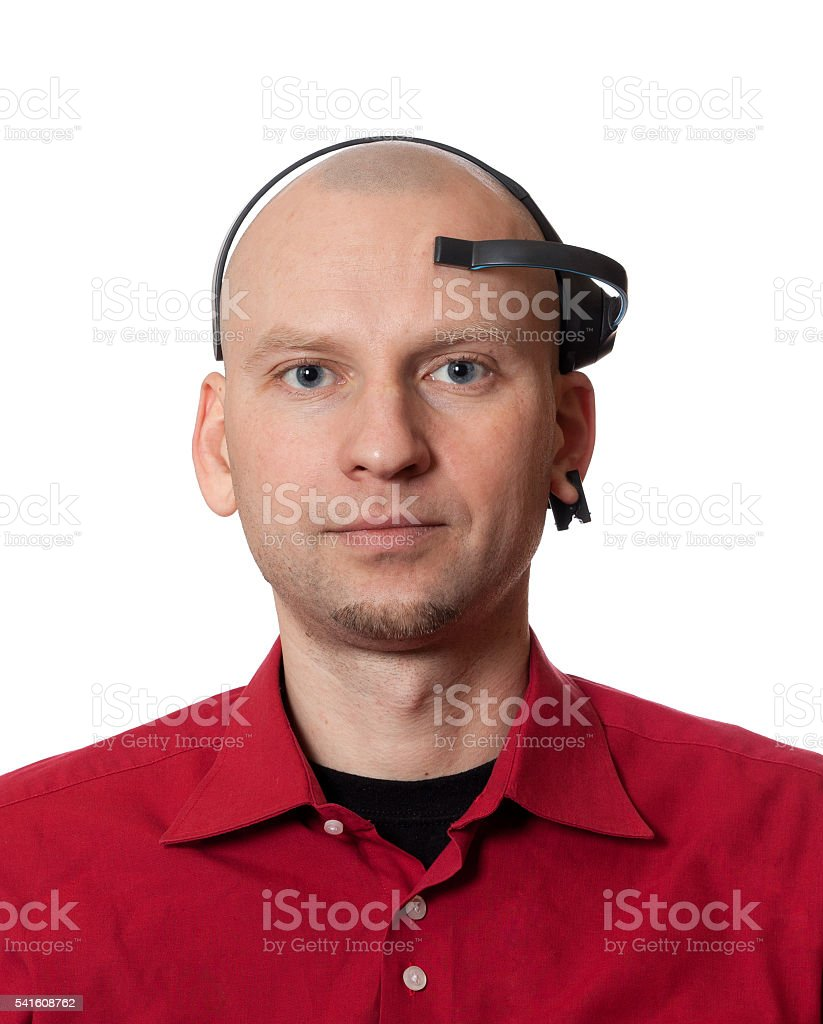 Portrait of young man with EEG (electroencephalography) headset stock photo