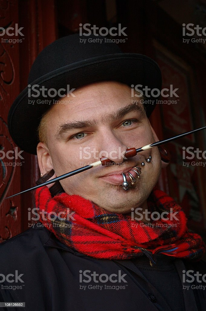 Portrait of Young Man with Facial Piercings stock photo