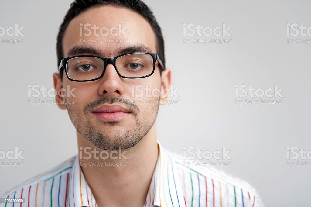 Portrait of young man with glasses stock photo