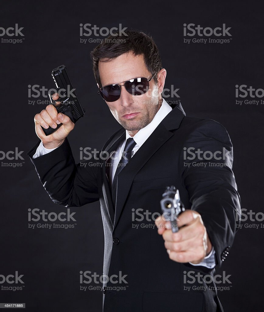 Portrait Of Young Man With Gun stock photo