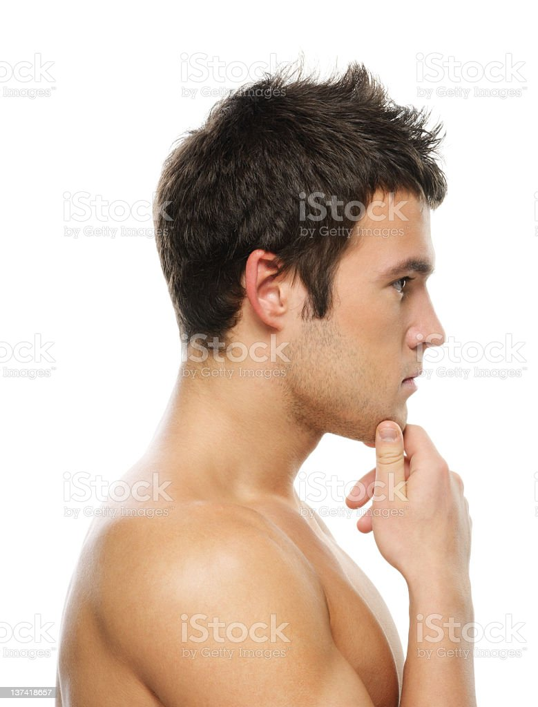 Portrait of young man with hand on his chin royalty-free stock photo