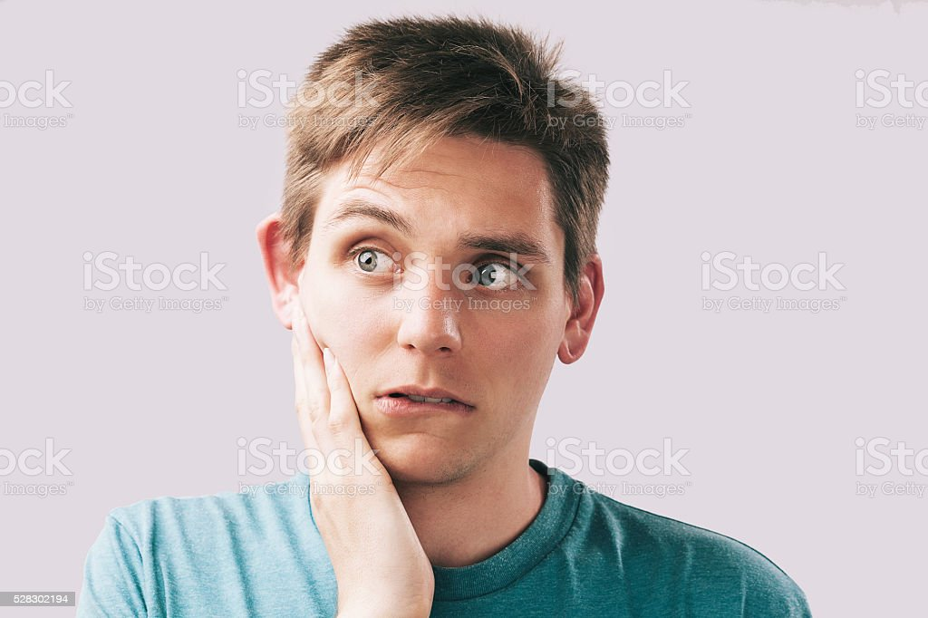 Portrait of young man with hand on the face stock photo