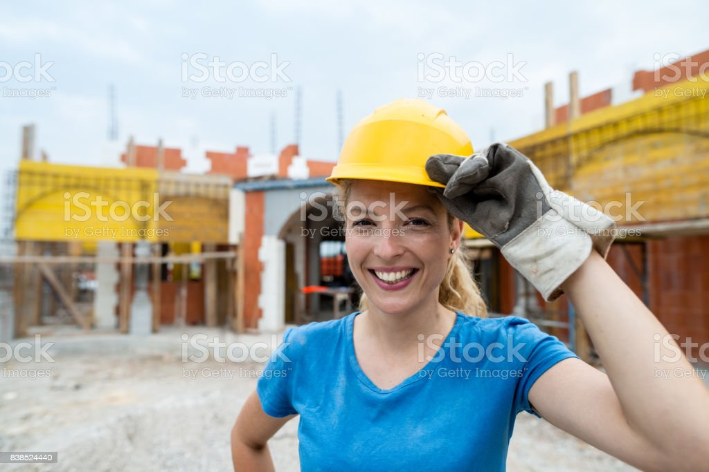 Portrait of young manual worker on construction site stock photo