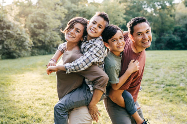 Portrait of young Mexican family stock photo