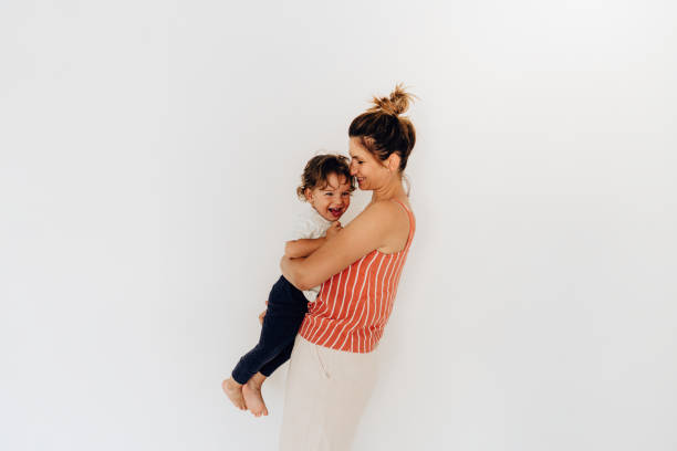Portrait of young mother and her son stock photo