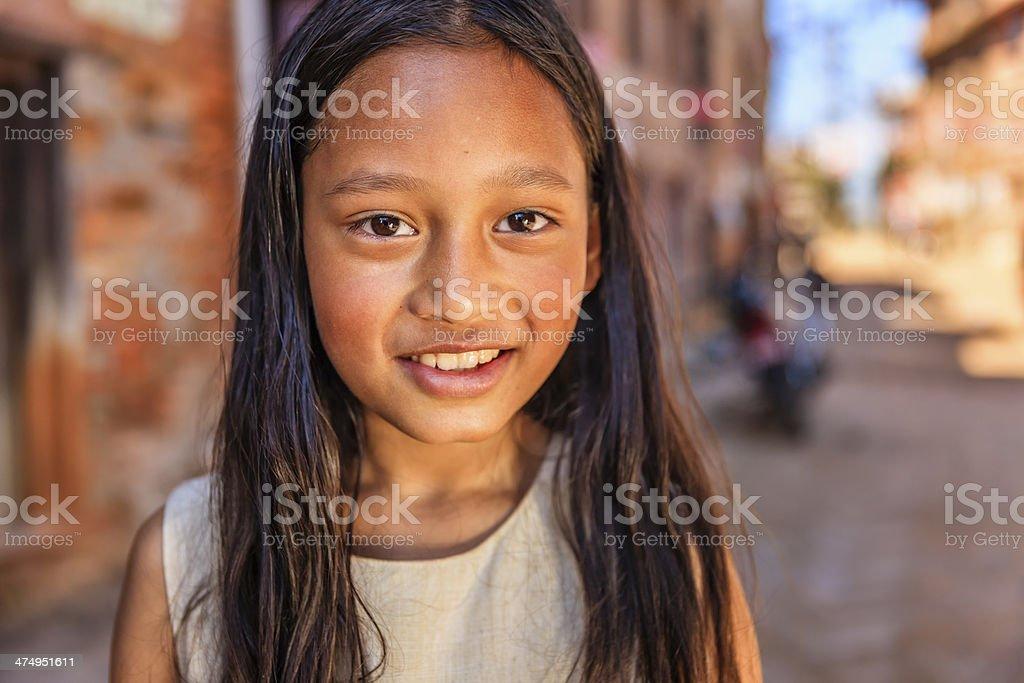 Portrait of young Nepali girl in Bhaktapur, Nepal stock photo