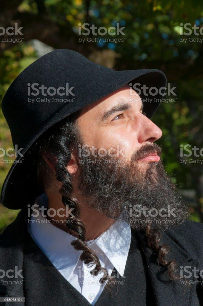 41cd6d98334 Portrait of young orthodox Hasdim Jewish man with black beard royalty-free  stock photo