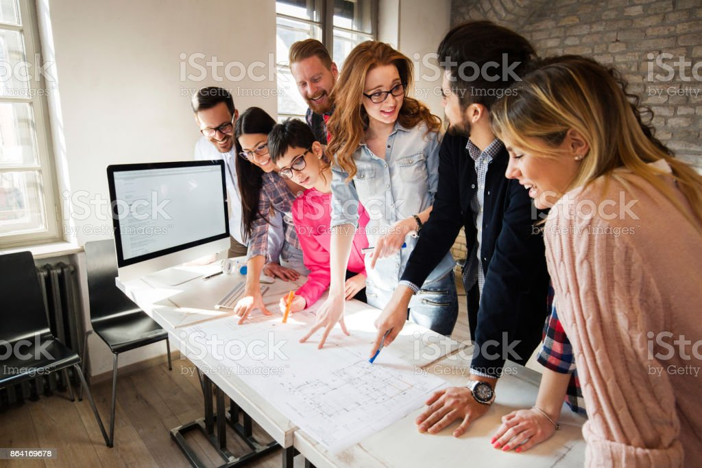 Portrait of young perspective designers having meeting royalty-free stock photo