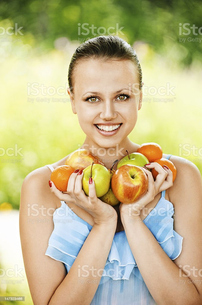 portrait of young pretty woman holding fruits royalty-free stock photo