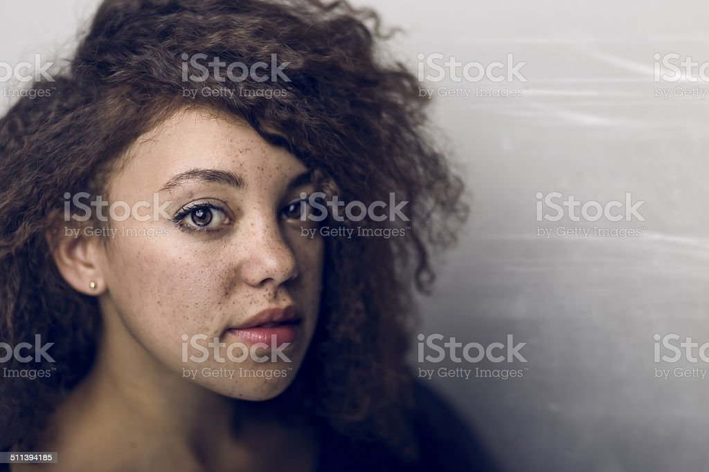 Portrait of Young Pretty Woman on Gray Scratched Background stock photo