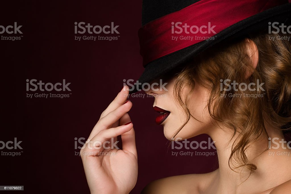 Portrait of young pretty woman with dark red lips stock photo