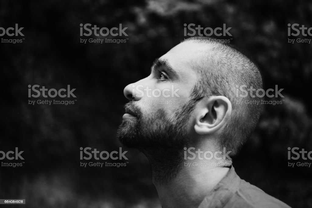 Portrait of  young sad man with short hair stock photo