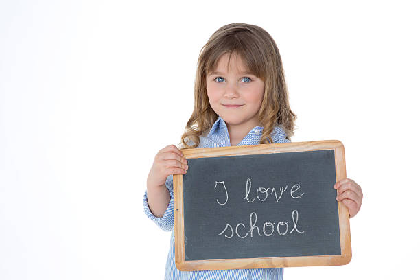 portrait of young school girl stock photo