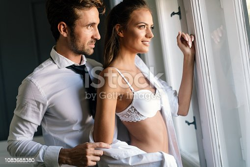 956369394 istock photo Portrait of young sensual couple in love embracing in bedroom 1083688380