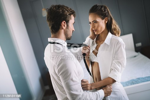 956369394 istock photo Portrait of young sensual couple in love embracing in bedroom 1129131198