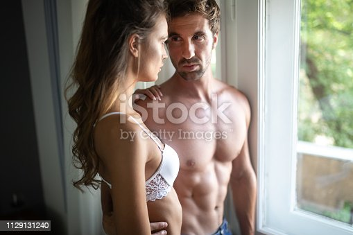 956369394 istock photo Portrait of young sensual couple in love embracing in bedroom 1129131240
