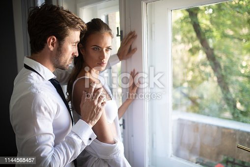 956369394 istock photo Portrait of young sensual couple in love embracing in bedroom 1144568457