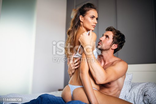 956369394 istock photo Portrait of young sensual couple in love embracing in bedroom 1144568706