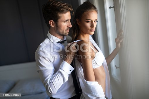 956369394 istock photo Portrait of young sensual couple in love embracing in bedroom 1154323043