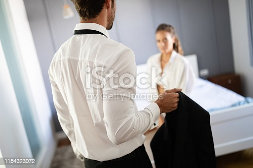 956369394 istock photo Portrait of young sensual couple in love embracing in bedroom 1154323072